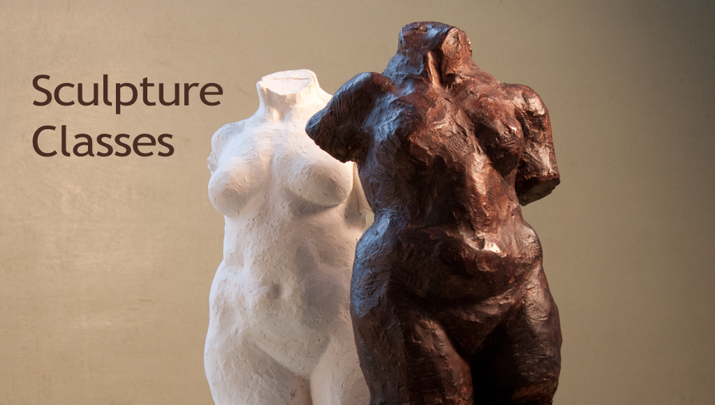 two plaster sculptures of female torso